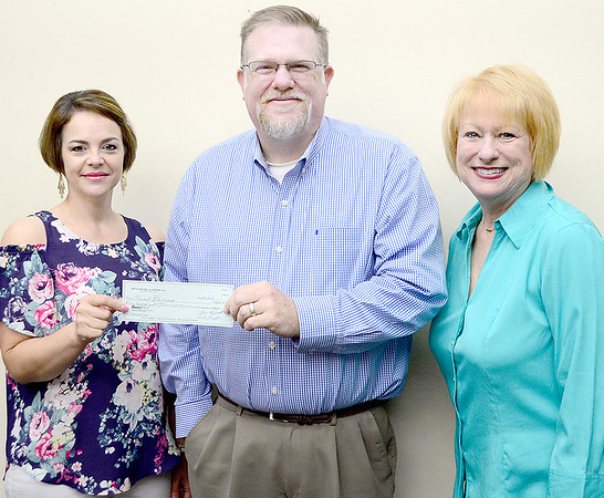 Kevin Harvison | Staff photo<br /> Beta Iota of McAlester presented Shared Blessings with a donation. Pictured from left are, Jeanie McCabe, Scott Walker, Shared Blessings and Ann Owens.