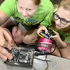 Kevin Harvison | Staff photo<br /> McAlester Public Schools hosted its first McAlestser High School STEM Camp for grades 5 to 12. STEM stands for Science, Technology, Engineering and Math; will use coding, computer science and engineering along with the TI-Inspire Calculators to solve problems during the four-day camp. Pictured from left working on a project, Emily Shelton and Cydnee Brown team up to engineer a hoist to retreave a rover.