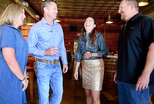 Kevin Harvison   Staff photo<br /> Pictured from left, Amy Grace, Clay Padgett his wife Amy Padgett and Jack Grace enjoy a visit during Padgett watch party in McAlester.