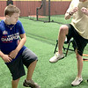 Kevin Harvison | Staff photo<br /> Pictured from left, Hayden Harvison gets works on his balance with pitching coach Brian Shackelford on Harvison's first day of pitching lessons with Shackelford at D-Bat Oklahoma City in Oct. 1 2017.