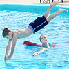 Kevin Harvison | Staff photo<br /> K.D. Wilson executes his first dive during Level 3-4 Swim Lessons at Jeff Lee Pool as Life Guard Kelby Koonce watches.