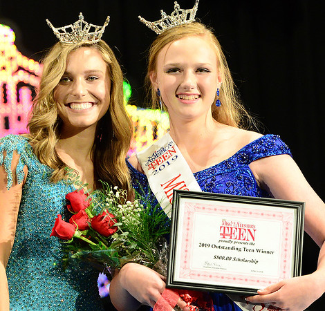 Kevin Harvison | Staff photo<br /> 2018 Miss McAlester Outstanding Teen Maddie Carr, left, poses with the new 2019 Miss McAlester Outstanding Teen Emilee Coxsey during the 2019 Miss McAlester Scholarship Pageant at S. Arch Thompson Auditorium Saturday.