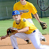 Kevin Harvison   Staff photo<br /> Oklahoma Gold second baseman Tanner Holliman, forground, makes a play on the ball during Junior Sunbelt Classic action Friday at Mike Deak Field against team Mississippi.