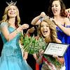 Kevin Harvison | Staff photo<br /> Pictured left, 2018 Miss McAlester's Outstanding Teen helps Miss McAlester 2018 Alexandria Williams, right, crown the new 2019 Miss McAletser Scholarship Pageant winner Marra Juarez at the S. Arch Thompson Auditorium Saturday night.