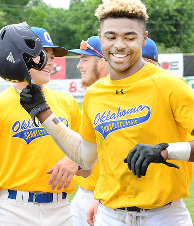 KEVIN HARVISON | Staff photo<br /> J'Briell Easley, right, of Oklahoma Gold celebrates his homerun against team Missouri Tuesday at Mike Deak Field during the Junior Sunbelt Classic.
