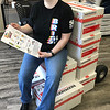 KEVIN HARVISON |<br /> Theresa Briggs, Office Manager for Briggs Printing, takes a break and rests on a make shift chair from boxes of paper in preparation for their School Supplie Drive.