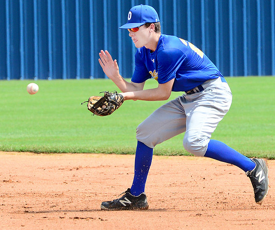 KEVIN HARVISON | Staff photo<br /> Oklahoma Blue second baseman makes the play for an out during opening day action of the Junior Sunbelt Classic at Eastern Oklahoma State College Friday.