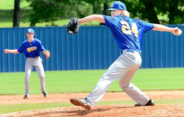 KEVIN HARVISON | Staff photo<br /> Oklahoma Blue starting pitcher delivers the ball to a Texas batter during opening play of the Junior Sunbelt Classic held at Eastern Oklahoma State College Friday.