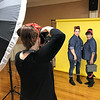 KEVIN HARVISON | Staff photo<br /> A photographer shoots pictures during the Rosie the Riveter themed Hope House Luncheon at the McAlester Country Club Friday.