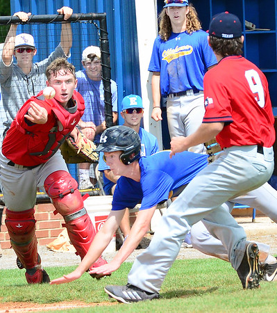 KEVIN HARVISON | Staff photo<br /> Oklahoma Blue scores a run on a pass ball against Texas during opening day of the Junior Sunbelt Classic at Eastern Oklahoma State College in Wilburton.