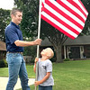 KEVIN HARVISON |<br /> Pictured from left, Sayer Brenner and his son Austen Brenner work to put out a U.S. Flag for Rotary Club of McAlester Friday morning.