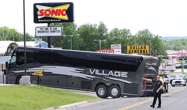 KEVIN HARVISON |<br /> A McAlester Police Officer directs traffic from a bus that is caught up on the entrance of the Sonic at 1010 N. Main Street in McAlester.