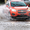 KEVIN HARVISON | Staff photo<br /> Vehicles on Wyndotte Avenue came to a crawl for a short time Monday morning as a thunderstorm dropped a large amount of rain in several minutes causing some roadways to have excesive amounts of water for a short period of time.