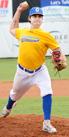 KEVIN HARVISON | Staff photo<br /> Oklahoma Gold pitcher delivers a strike during Junior Sunbelt Classic action Tuesday at Mike Deak Field.