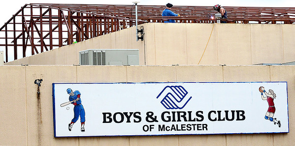 KEVIN HARVISON | Staff photo<br /> Construction continues on the new roof for the McAlester Boys and Girls Club on Chadick Avenue by Mike MIller Construction company.