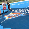 KEVIN HARVISON |<br /> Pictured from left, Alexas Lizik guards Davonte Jones as he tries to dribble past Jonathan Lizik while enjoying the new Thunder Court at Chadick Park.