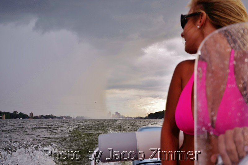 A boater attempts to out run a rain storm blowing across the Ohio River. August 2013.