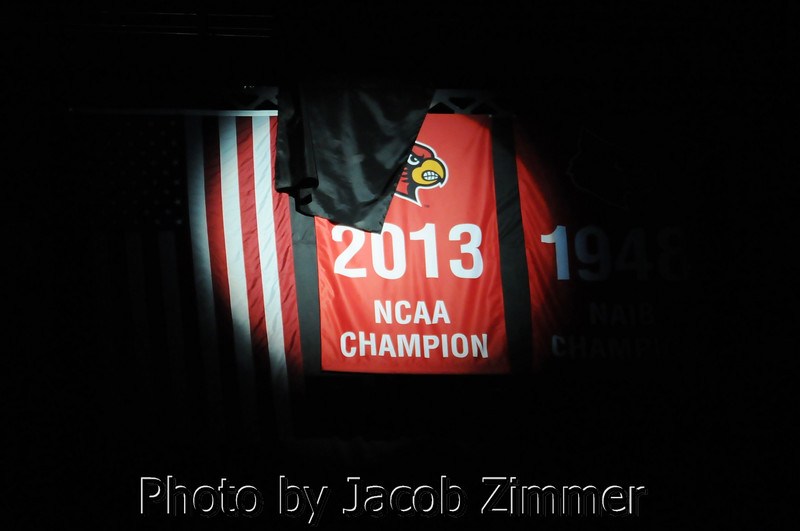 Louisville's regular season opener against Charleston began with the unveiling of the 2013 NCAA Championship banner in the rafters of the KFC YUM! Center Saturday. November 9, 2013.
