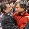 Coach Rick Pitino and Athletic Director Tom Jurich embrace after the victory over Duke in the Elite Eight in Indianapolis.