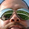 A view of the field reflected off Geno Hardin's sunglasses at the Blondes vs. Brunettes Flag Football game benefiting the Alzheimer's Association at Trinity High School. Saturday, June 15, 2013.
