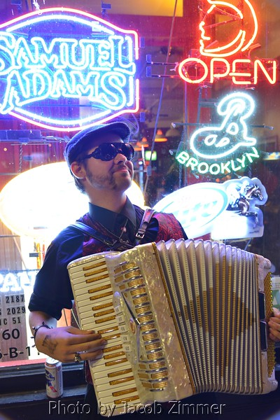 John Brodie played the accordion outside the Haymarket Whiskey Bar for the NOIR party.