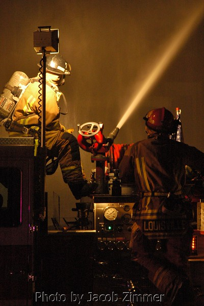 Louisville Firefighters put out a blaze on Bonnycastle in the Highlands. March 2008.