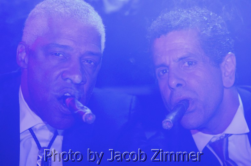 Julius Irving and friend enjoy cigars in the VIP section of the 4th Annual Fillies and Stallions Derby Eve party at the Mellwood Arts Center Friday Night. May 2, 2014.