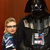 Star Wars actress and best-selling author Carrie Fisher poses for a photo with a costumed Darth Vader before going on stage for a Q&A at FandomFest 2015 in the KY International Convention Center on Saturday, August 8, 2015.