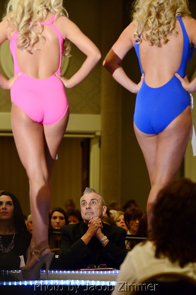 A judge reviews contestants in the 2015 Miss Kentucky County Fair Pageant at the Galt House Saturday night. January 17, 2015.
