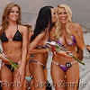 Contestants react to announcements of the top eight winners in the regional bikini contest at the Dupont Hooters with women from KY, IN, TN and OH competing for a chance to travel to Las Vegas for the national competition. Friday May 30, 2014.