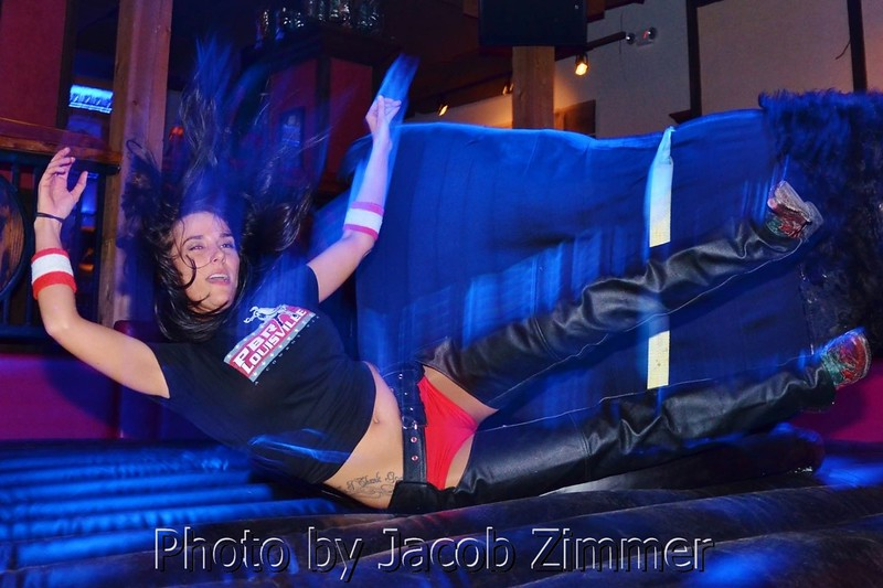 Lindsey takes a fall off the mechanical bull at PBR Louisville.