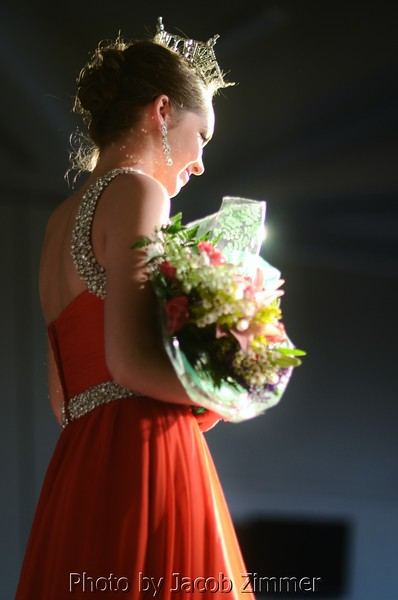 2012 Miss UofL Claire Butler basks in the spotlight at the end of the runway.