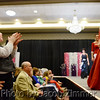 C.J. Carder applauds for contestants on the runway at the Miss KY County Fair Pageant held in the Grand Ballroom of the Galt House on Saturday evening. January 18, 2014.