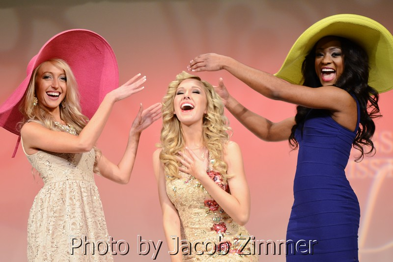 """Contestants act out a crowning during the """"Derby Fashion Show"""" segment at the 2015 Miss Kentucky USA Pageant at the Ursuline Arts Center Sunday night. January 11, 2015."""