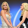 Katie George and Emily Bryant await for the announcement of who will be crowned at the 2015 Miss Kentucky USA Pageant at the Ursuline Arts Center Sunday night. January 11, 2015.