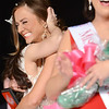 The 2014 Miss UofL June Clark is embraced by Amelia Gandara with Hannah Estes in the foreground at the 2014 Miss UofL Pageant Wednesday evening in the Student Activities Building. March 5, 2014.