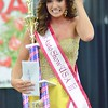 Monica Robertson caught her tiara after crowned the 2013 Miss Auto Show USA Pageant winner.