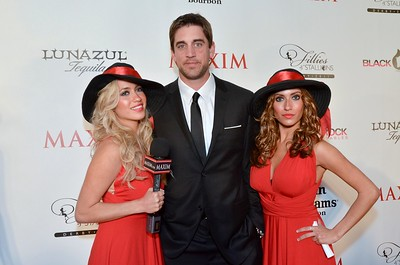 Aaron Rogers flanked my Maxim models on the red carpet at the Maxim Derby Eve Party, May 6, 2011.