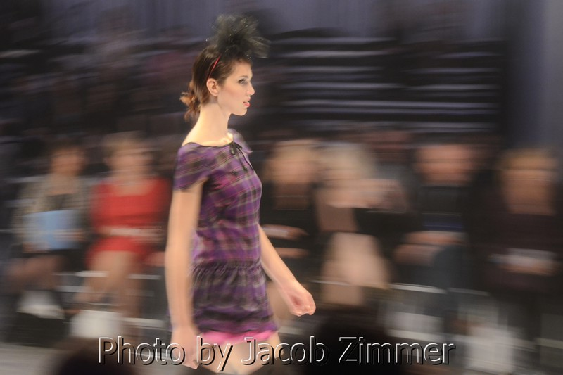 A model struts the runway at Waterfront Fashion Week. October, 2012.