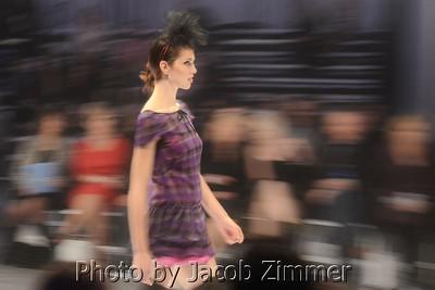 A model struts the runway at Waterfront Fashion Week. October, 2012.