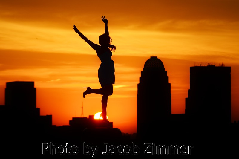 Dancing at dusk downtown. This photo won Second Place in the Illustrative category in the Kentucky News Photographers Association contest. 2012.