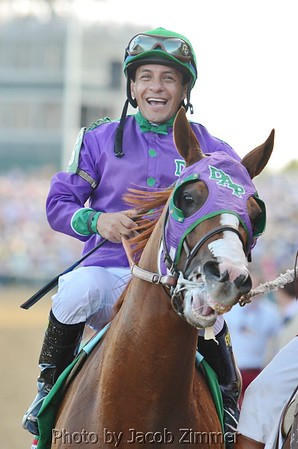 Jockey Victor Espinoza riding California Chrome shortly after winning the  140th Kentucky Derby. May 3, 2014.