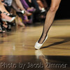 A model walks the runway for the LUXE Fashion Experience at the Ice House Thursday night. October 3, 2013.