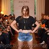Model Mackenzie Nevill on the runway at the Anchal Urban Renewal Fashion Show at the Peterson-Dumesnil House Wednesday evening. October 17, 2013.