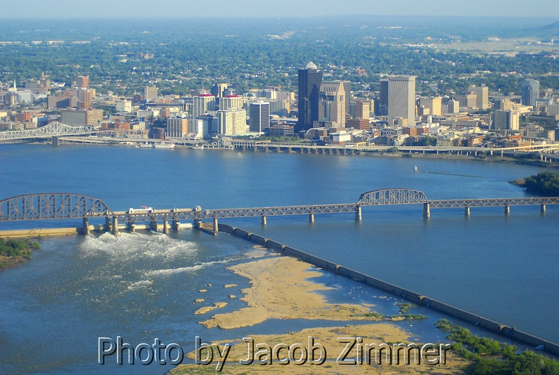 View of Downtown Louisville at the Ohio River, with the Norfolk Southern Railroad bridge, McAlpin Dam and Falls of the Ohio in the foreground.