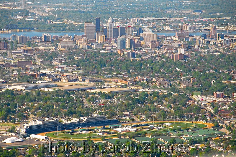 With Downtown Louisville in the background, the famous Churchill Downs Racetrack is seen in the foreground.