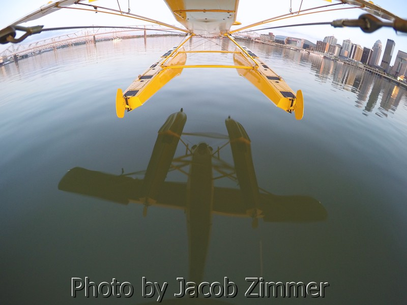 The seaplane reflects off the Ohio River as the pilot attempts a landing.