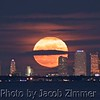 The full moon rise over downtown Tampa, FL, as seen from St. Petersburg across Tampa Bay. Sunday December 3, 2017. Photo by Jacob Zimmer zymage.com