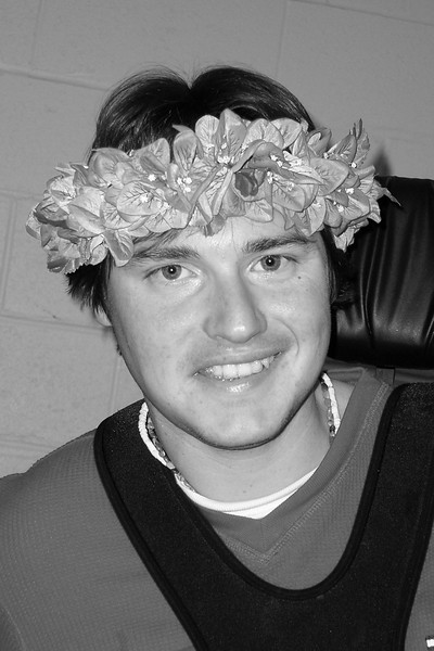 Graham wearing a lei brought  to him from Hawaii by Donna.