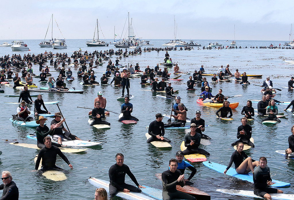 . Thousands of surfers float in the Monterey Bay near Pleasure Point in Santa Cruz on Sunday morning during a paddle-out in honor of surfing pioneer Jack O\'Neil. (Kevin Johnson -- Santa Cruz Sentinel)